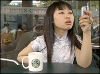 Woman at Starbucks outlet in Beijing