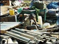 A boy looks after his family home after the property was destroyed west of Harare, Zimbabwe (30 June)