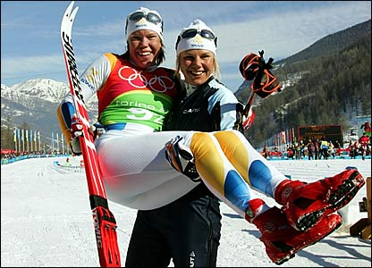 Sweden's Anna Dahlberg carries team-mate Lina Andersson