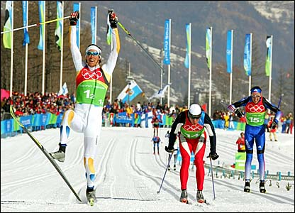 Sweden's Bjoern Lind (left) crosses the finish line ahead of Norway's Tor Arne Hetland (centre) and Russia's Vassili Rotchev