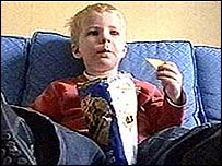 Image of a boy eating crisps