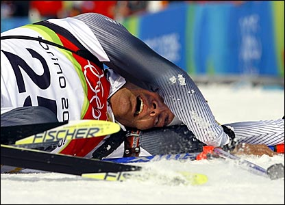 Germany's Sven Fischer collapses after crossing the finishing line to win gold