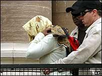 The alleged rape victim enters court
