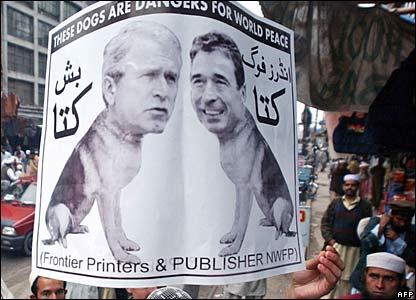 Pictures of US President George W Bush and Danish Prime Minister Anders Fogh Rasmussen (R) during a protest in Peshawar.