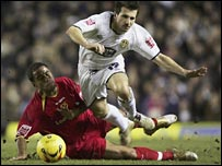 Watford's James Chambers tackles Liam Miller