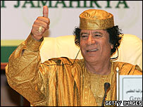 Colonel Gaddafi gives the thumbs up
