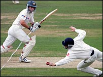 Simon Katich sees a possible four stopped by Ian Bell