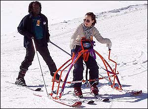 Photo of someone using the Demand skiing frame with an instructor behind
