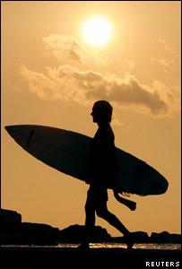 A surfer on the beach at Hikkaduwa