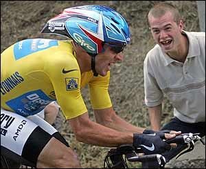 A fan cheers on Lance Armstrong