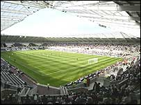 Fans watch Swansea v Fulham at the New Stadium