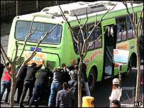 Passengers try to push start stalled bus in Beijing
