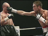 Alex Arthur lands a punch on Boris Sinitsin