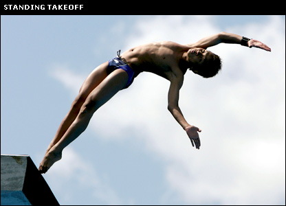 A diver begins a platform dive using a standing take-off