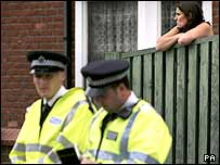 Stockwell resident looks on as police investigate