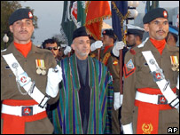 Mr Karzai inspects a Pakistani military parade