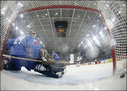 Italy netminder Jason Muzzatti watches as Canada score again