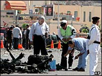 Egyptian security men check the remains of a bombed car at Sharm el-Sheik old market