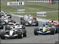 Kimi Raikkonen leads Fernando Alonso into the first corner at the German Grand Prix