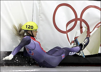 Sarah Lindsay ends up in the boards during the quarter-finals but still qualifies