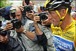 Lance Armstrong has his photo taken