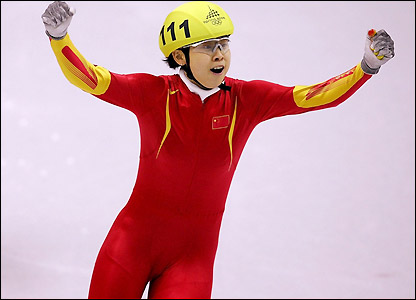 Wang Meng crosses the line and takes gold for China