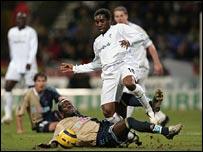 Jay-Jay Okocha wins possession for Bolton against Marseille