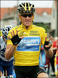 Lance Armstrong raises seven fingers to represent his Tour wins