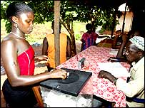 Woman voting in Bissau