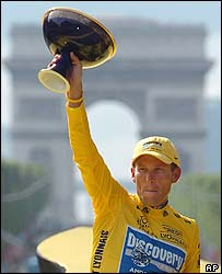 Lance Armstrong with the Tour de France trophy