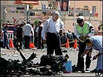 Egyptian security men check the remains of a bombed car in the Old Market area of Sharm al-Sheikh