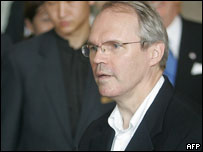 US assistant secretary of state for East Asia-Pacific affairs Christopher Hill (R) speaks to the press on arrival at a hotel in Beijing, 24 July 2005