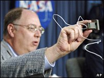 Wayne Hale holds up shuttle fuel sensor (AP)