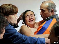 Maria Otonio de Menezes, Mr Menezes' mother, is comforted by relatives, in Gonzaga, Brazil