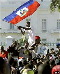 Preval supporters celebrate his win outside the presidential palace