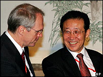 Christopher Hill of the US and North Korea's Kim Kye-gwan
