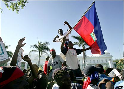 Preval supporters celebrate outside the presidential palace, Port-au-Prince
