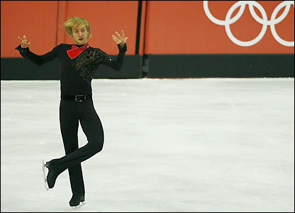 Russian figure skater Evgeni Plushenko thrills the crowd with a near-flawless performance
