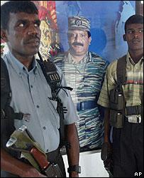Tamil Tigers in front of a picture of rebel leader Prabhakaran
