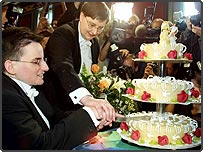 German lesbian Gudrun Pannier helps her partner Angelika Baldow, left, to cut the wedding cake in Berlin