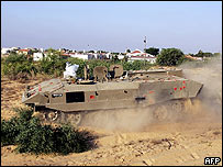 Israeli armoured vehicle driving around Ganei Tal settlement