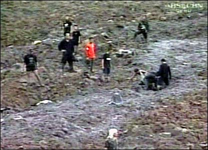 Rescue workers at the scene of the mudslide