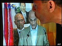 Supporter kisses TV screen showing Geagea's first press conference aftere release