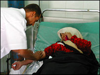 Doctor with a wounded woman at Yarmouk hospital in Baghdad