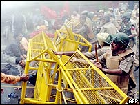 Indian police fighting off protestors with the help of a water canon