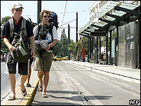 Tourists walk past a deserted tram station in central Athens during the 24-hour strike