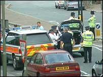 Police examine white VW Golf (pic: Andrew Lim)