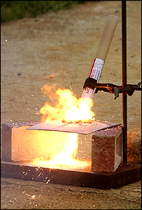 A Dragon burns through a piece of steel plate