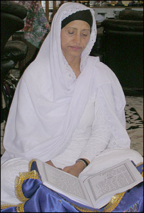 Gurdev Kaur reading from the Guru Granth Sahib, the Sikh book of scripture