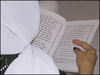 Sikh Nari Manch member reading scripture